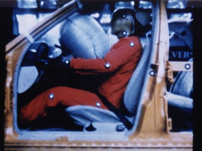 A crash test that shows how dummies are colliding with the airbag after an accident.