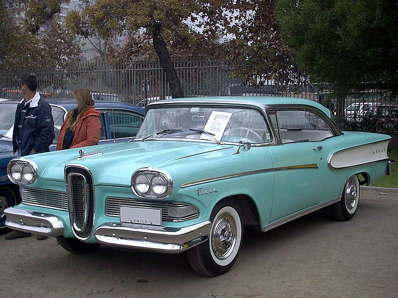A 1958 turquoise Edsel in a parking lot.