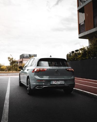 A grey Volkswagen Golf parked.
